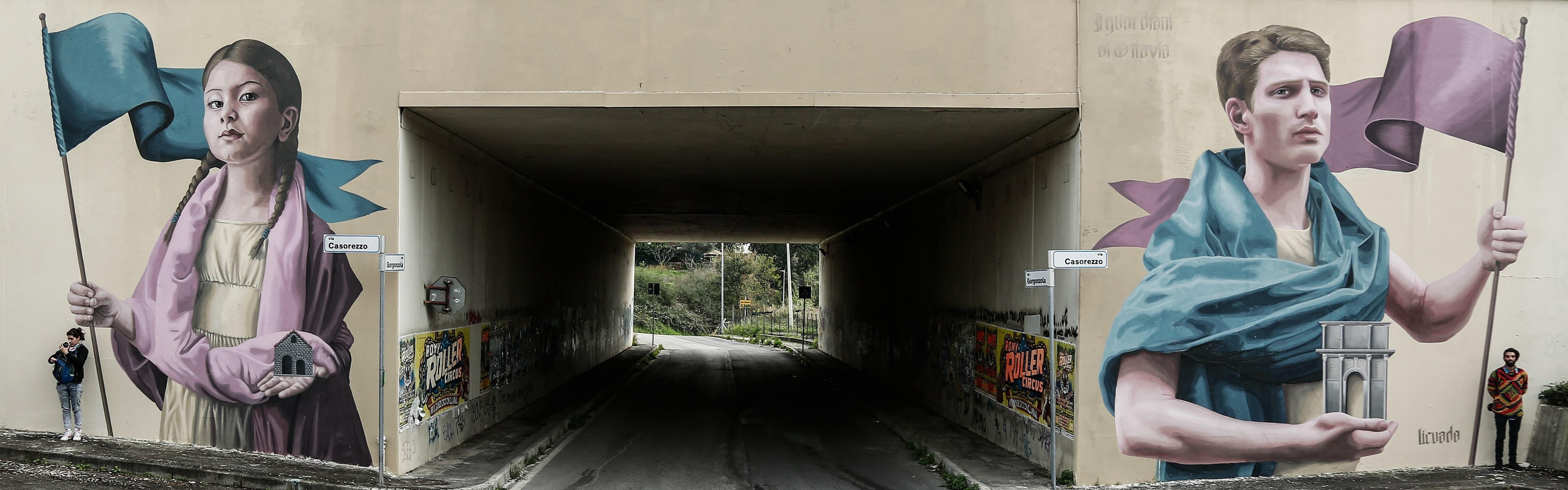 Immagine di una galleria con dei graffiti all'ingresso