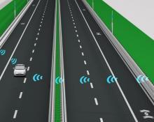 This is a graphic image of a road with a car traveling on it. There are symbols in the air that represent the wifi connection between the infrastructure and the vehicle